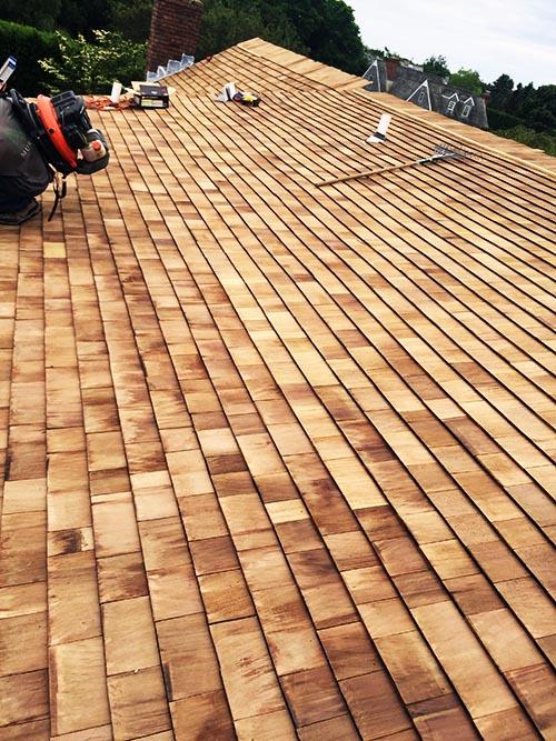 A cedar shake roof and siding job on Long Island
